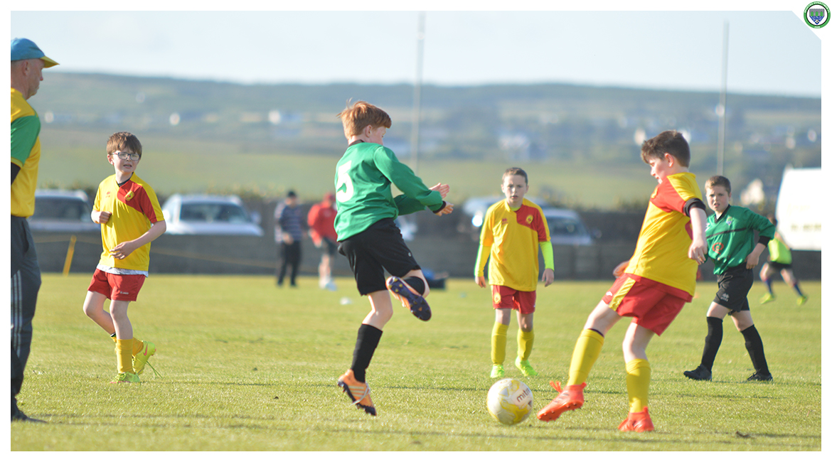 Darragh Cassidy attempts to block a clearance from an Avenue United defender in the U12 game between Sporting Ennistymon Football Club and Avenue United Football Club. Game played in Lahinch Sportsfield on the 11th of June 2019.