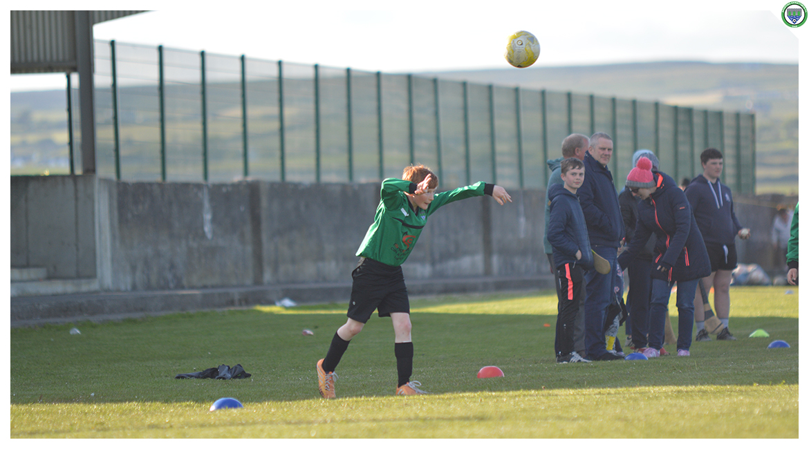 Darragh Cassidy takes a throw-in in the U12 game between Sporting Ennistymon Football Club and Avenue United Football Club. Game played in Lahinch Sportsfield on the 11th of June 2019.