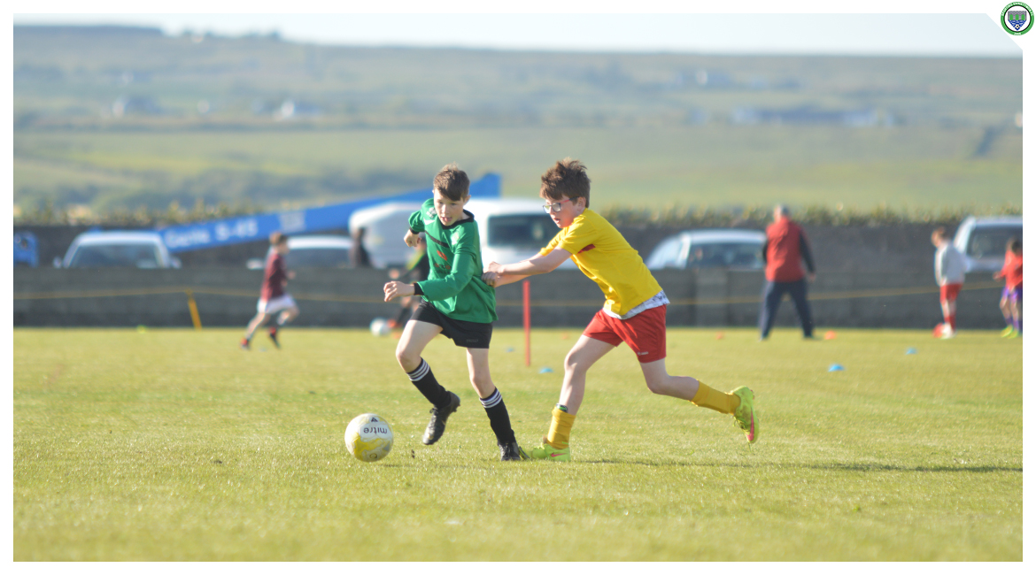 Louis Griffin is pushed in the back by an Avenue United opponent in the U12 game between Sporting Ennistymon Football Club and Avenue United Football Club. Game played in Lahinch Sportsfield on the 11th of June 2019.