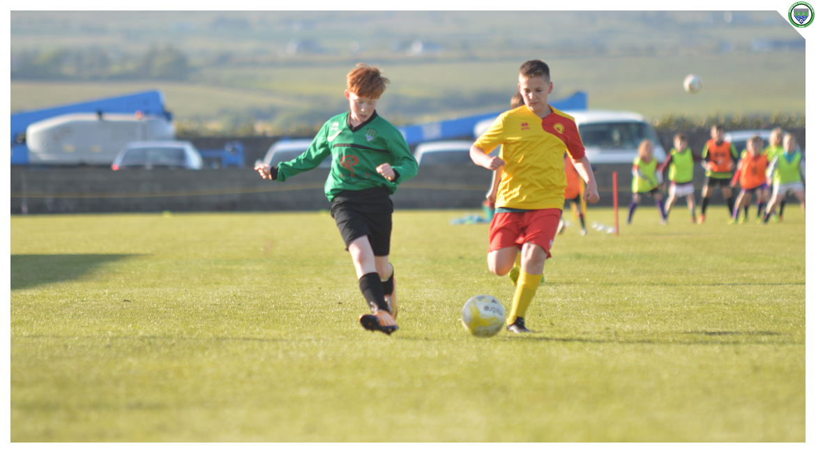 Darragh Cassidy plays a pass to a Sporting teammate in the U12 game between Sporting Ennistymon Football Club and Avenue United Football Club. Game played in Lahinch Sportsfield on the 11th of June 2019.