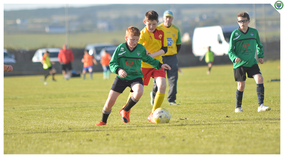 John O'Brien beats an Avenue United player in the U12 game between Sporting Ennistymon Football Club and Avenue United Football Club. Game played in Lahinch Sportsfield on the 11th of June 2019.