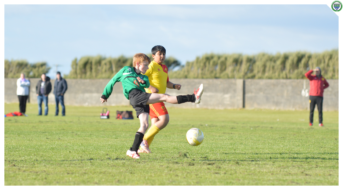Darren O'Brien shoots goalward in the U12 game between Sporting Ennistymon Football Club and Avenue United Football Club. Game played in Lahinch Sportsfield on the 11th of June 2019.