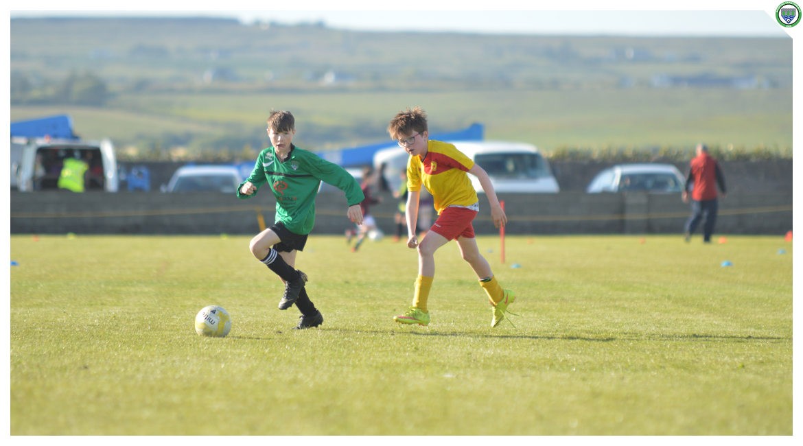 Louis Griffin advances up the pitch in the U12 game between Sporting Ennistymon Football Club and Avenue United Football Club. Game played in Lahinch Sportsfield on the 11th of June 2019.