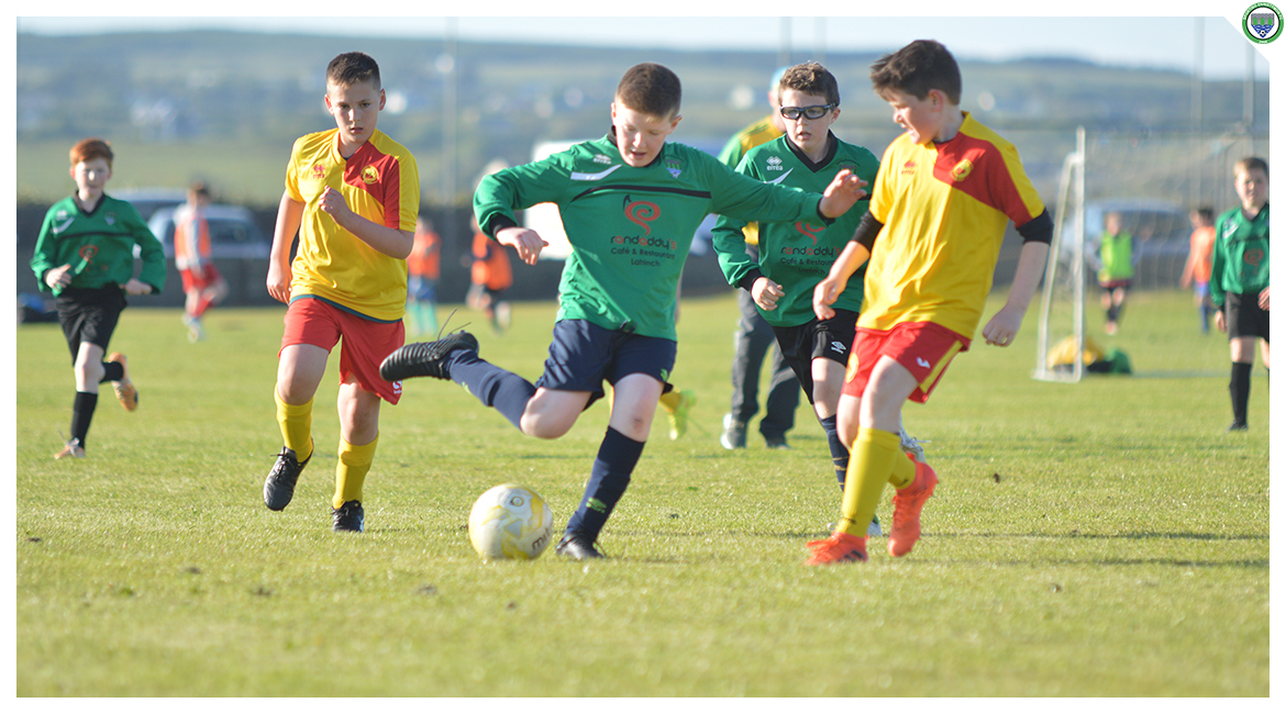 Liam O'Looney passes the ball to a Sporting teammate in the U12 game between Sporting Ennistymon Football Club and Avenue United Football Club. Game played in Lahinch Sportsfield on the 11th of June 2019.