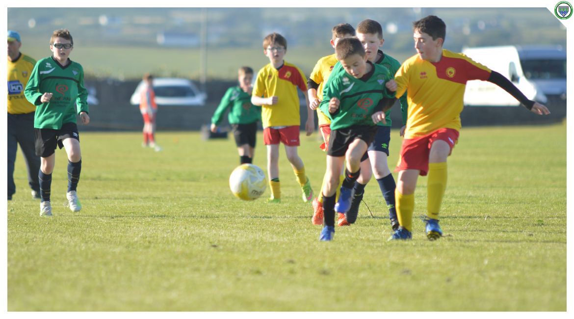 Ultan McDonagh is tackled by an Avenue United player in the U12 game between Sporting Ennistymon Football Club and Avenue United Football Club. Game played in Lahinch Sportsfield on the 11th of June 2019.
