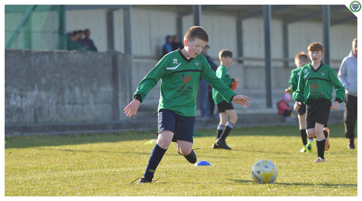 Liam O'Looney steadies himself before crossing the ball in the U12 game between Sporting Ennistymon Football Club and Avenue United Football Club. Game played in Lahinch Sportsfield on the 11th of June 2019.