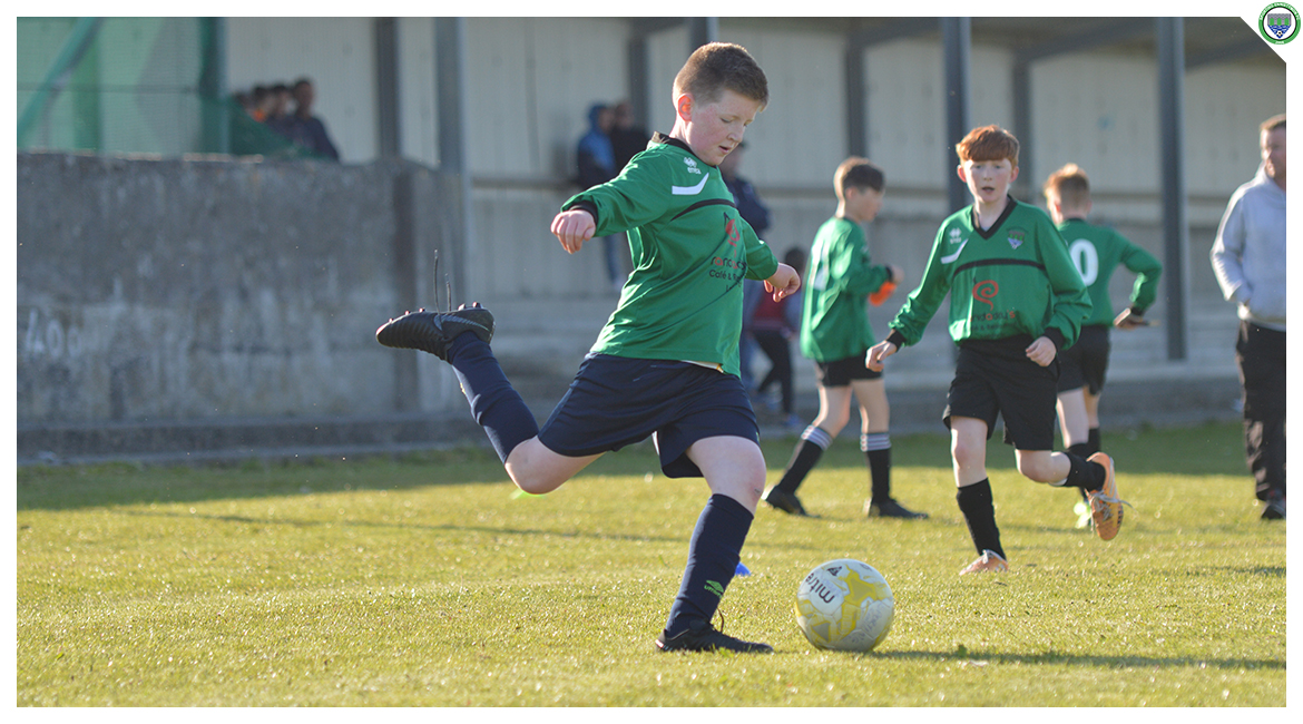 Liam O'Looney crosses the ball in the U12 game between Sporting Ennistymon Football Club and Avenue United Football Club. Game played in Lahinch Sportsfield on the 11th of June 2019.