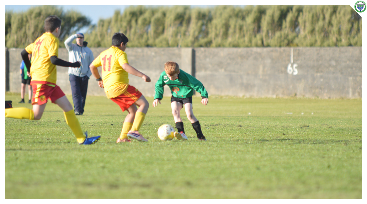 Darren O'Brien dribbles past an Avenue United counterpart in the U12 game between Sporting Ennistymon Football Club and Avenue United Football Club. Game played in Lahinch Sportsfield on the 11th of June 2019.