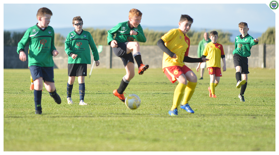Darren O'Briens shot is deflected off an Avenue United player in the U12 game between Sporting Ennistymon Football Club and Avenue United Football Club. Game played in Lahinch Sportsfield on the 11th of June 2019.