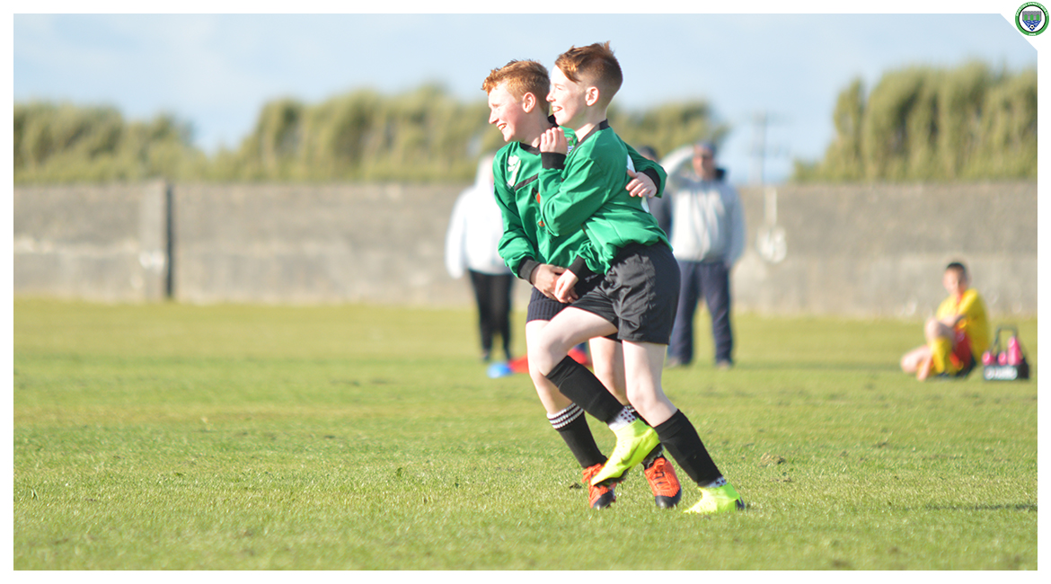 Eoin Devanney and John O'Brien celebrate a goal scored in the U12 game between Sporting Ennistymon Football Club and Avenue United Football Club. Game played in Lahinch Sportsfield on the 11th of June 2019.