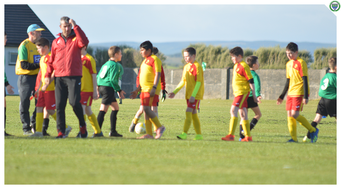 Players and Management of both Sporting Ennistymon and Avenue United shake hands after the U12 game between Sporting Ennistymon Football Club and Avenue United Football Club. Game played in Lahinch Sportsfield on the 11th of June 2019.