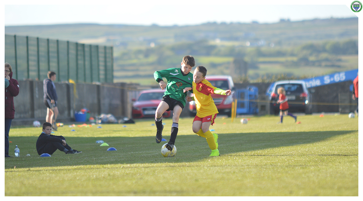Louis Griffin cuts back whilst coming under pressure from an Avenue United opponent in the U12 game between Sporting Ennistymon Football Club and Avenue United Football Club. Game played in Lahinch Sportsfield on the 11th of June 2019.