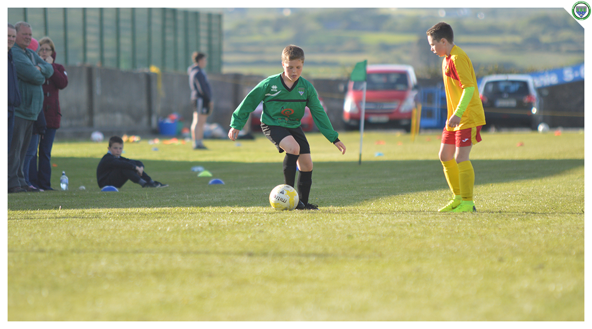 Daniel Brody dribbles towards goal in the U12 game between Sporting Ennistymon Football Club and Avenue United Football Club. Game played in Lahinch Sportsfield on the 11th of June 2019.