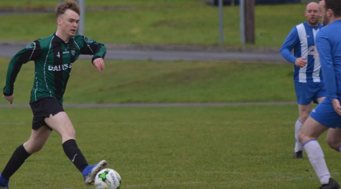 Sporting Ennistymon's, Michael Leigh advances past the Turnpike Rovers defence.