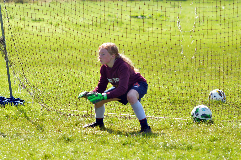 Shauna Coughlan readies herself to save a shot during the Sporting Ennistymon FAI Summer Camp 2020