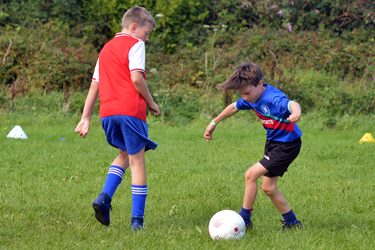 Thomas Slavin in action against Killian O'Neil during the Sporting Ennistymon F.C F.A.I Summer Camp 2020