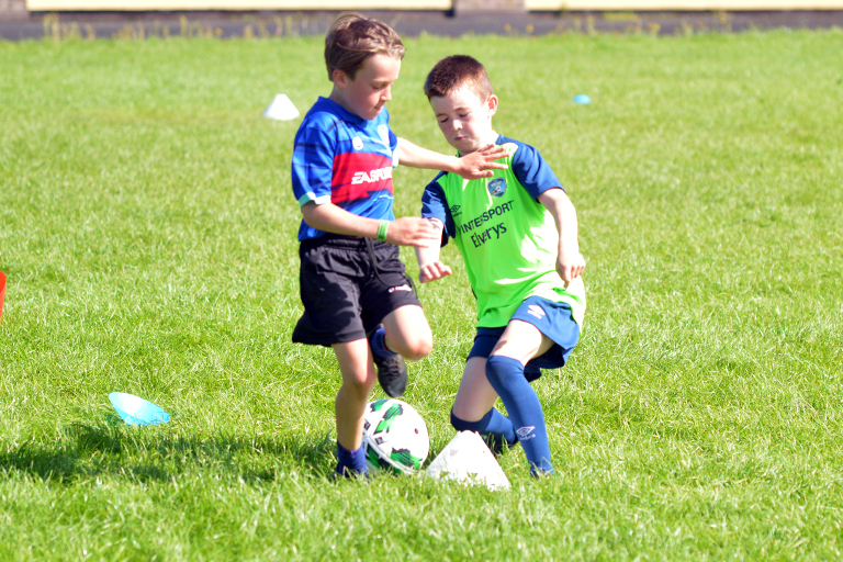 Cobhan Fahy in action against Thomas Slavin during Sporting Ennistymon F.C FAI Summer Camp 2020