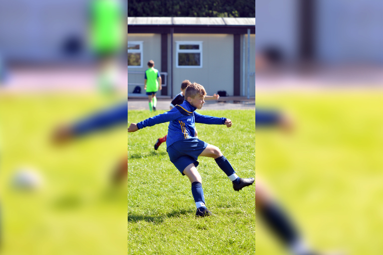 Tommy Flynn hits a volley during Sporting Ennistymon F.C FAI Summer Camp 2020