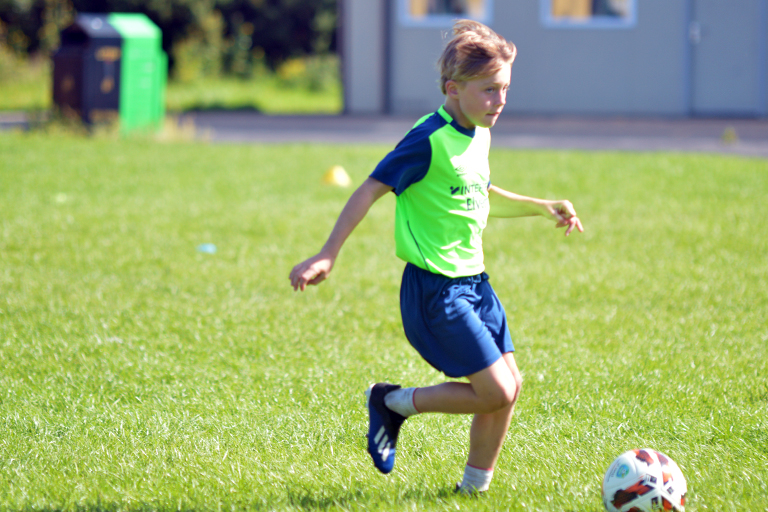 Hugo Roberts dribbles with the ball during Sporting Ennistymon F.C FAI Summer Camp 2020