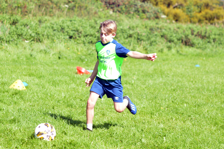 Hugo Roberts shoots during Sporting Ennistymon F.C FAI Summer Camp 2020