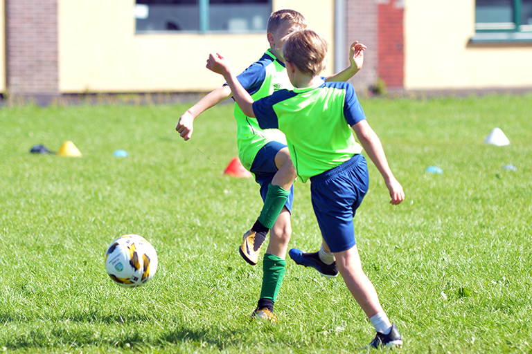 Hugo Roberts in action vs Harry O'Sullivan during Sporting Ennistymon F.C FAI Summer Camp 2020