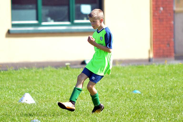 Harry O'Sullivan plays a pass during Sporting Ennistymon F.C FAI Summer Camp 2020