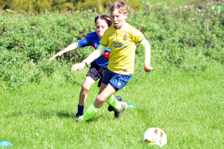 Liam Flynn and Thomas Slavin in action during Sporting Ennistymon F.C FAI Summer Camp 2020