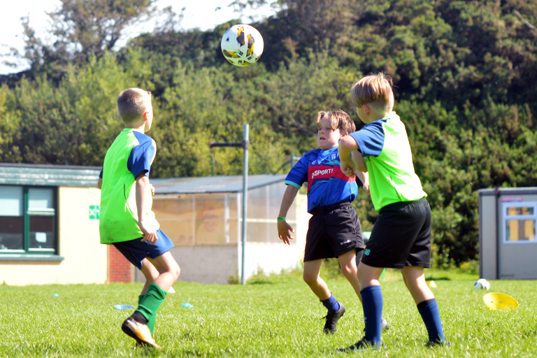 Harry O'Sullivan and Thomas Slavin compete for a high ball during Sporting Ennistymon F.C FAI Summer Camp 2020