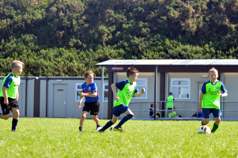 Harry O'Sullivan competes with Cobhan Fahy for the ball during Sporting Ennistymon F.C FAI Summer Camp 2020