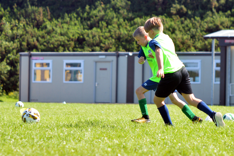 Harry O'Sullivan dribbles during Sporting Ennistymon F.C FAI Summer Camp 2020