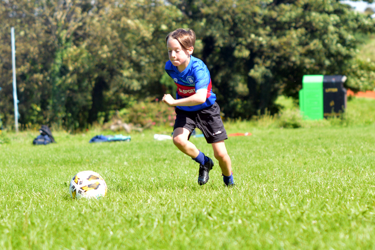 Thomas Slavin chases down a loose ball during Sporting Ennistymon F.C FAI Summer Camp 2020