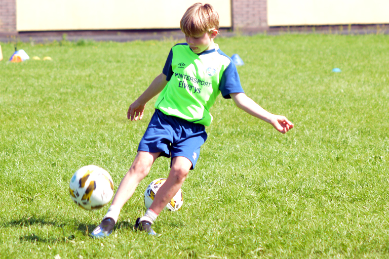 Hugo Roberts passes the ball during Sporting Ennistymon F.C FAI Summer Camp 2020