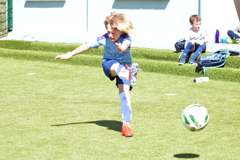 Rian O'Malley takes a shot during Sporting Ennistymon F.C FAI Summer Camp 2020