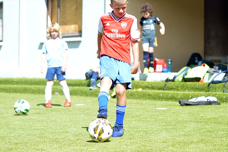 Killian O'Neil prepares to shoot during Sporting Ennistymon F.C FAI Summer Camp 2020