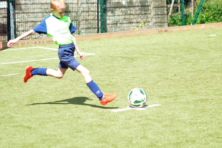 Ricky Rynne takes a shot during Sporting Ennistymon F.C FAI Summer Camp 2020