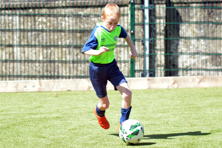 Ricky Rynne dribbles during Sporting Ennistymon F.C FAI Summer Camp 2020