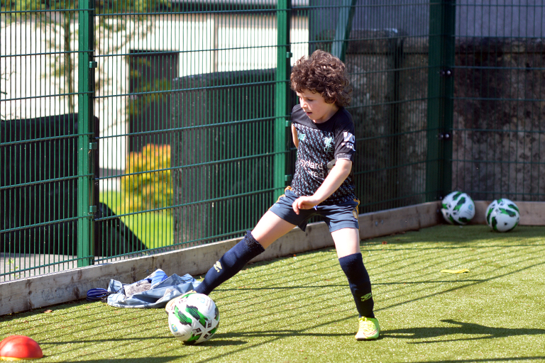 Patrick Shannon dribbles during Sporting Ennistymon F.C FAI Summer Camp 2020