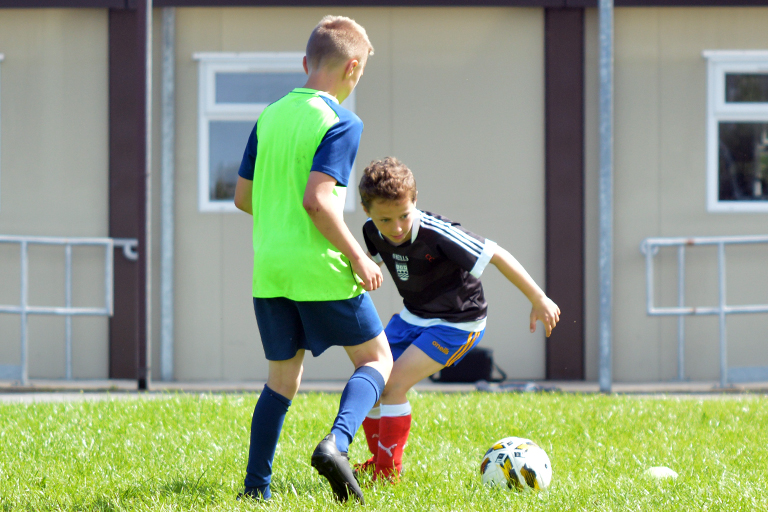 Cillian Curran in action vs Alan Blackwell during Sporting Ennistymon F.C FAI Summer Camp 2020