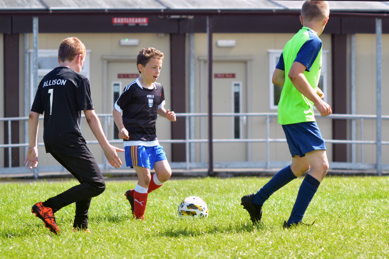 Cillian Curran in action vs Alan Blackwell and Darren O'Brien during Sporting Ennistymon F.C FAI Summer Camp 2020
