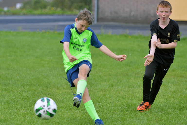Eoin O'Sullivan shoots during Sporting Ennistymon F.C FAI Summer Camp 2020