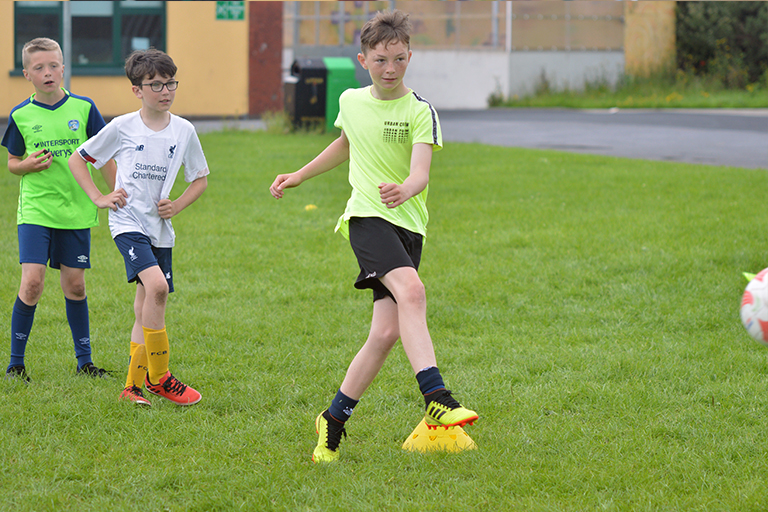 Cillian Power takes a shot during Sporting Ennistymon F.C FAI Summer Camp 2020