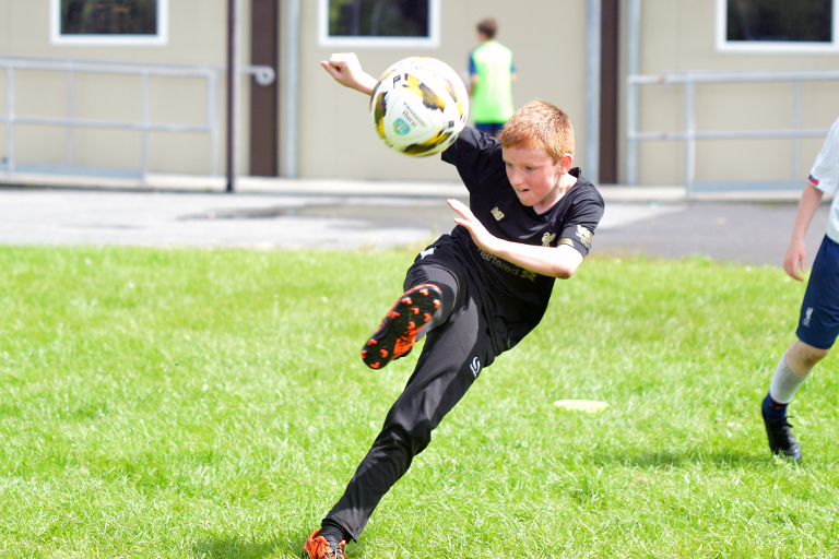 Darren O'Brien attempts a volley during Sporting Ennistymon F.C FAI Summer Camp 2020