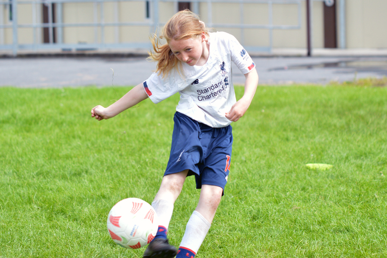 Shauna Coughlan hits a volley during Sporting Ennistymon F.C FAI Summer Camp 2020