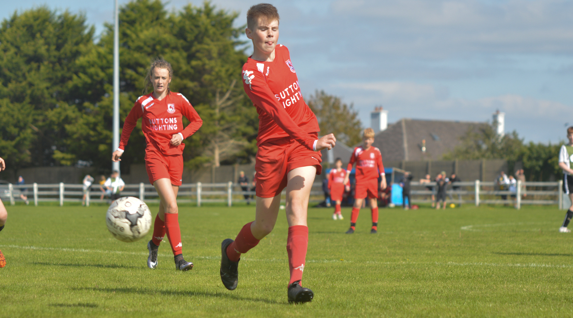 A Lifford AFC player clears the ball over the sideline in the U13 Division 2 Cup Final between Sporting Ennistymon F.C and Lifford A.F.C in Frank Healy Park.