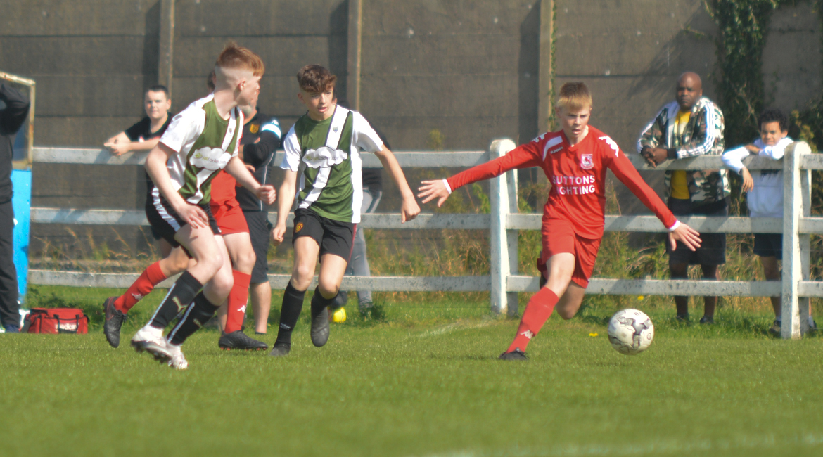 A Lifford AFC player disposes Joe Concannon in the U13 Division 2 Cup Final between Sporting Ennistymon F.C and Lifford A.F.C in Frank Healy Park.
