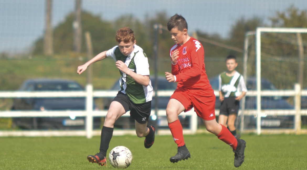 John O'Brien challenges for possesion against his Lifford AFC counterpart in the U13 Division 2 Cup Final between Sporting Ennistymon F.C and Lifford A.F.C in Frank Healy Park.
