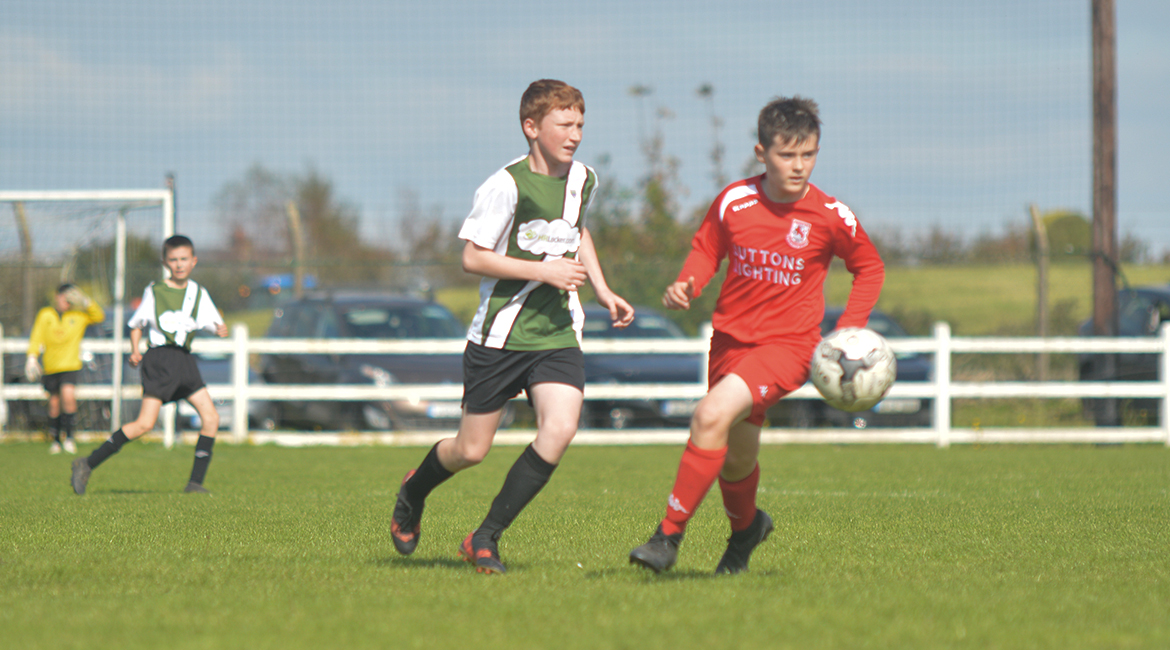 John O'Brien plays a pass in the U13 Division 2 Cup Final between Sporting Ennistymon F.C and Lifford A.F.C in Frank Healy Park.