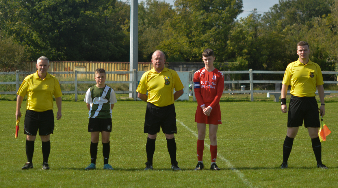 Captain, Daniel Brody poses for a photo with the Lifford AFC Captain, Referee Sean Keneally and Linesmen Dermot Kirby and Dylan Shannon in the U13 Division 2 Cup Final between Sporting Ennistymon F.C and Lifford A.F.C in Frank Healy Park.