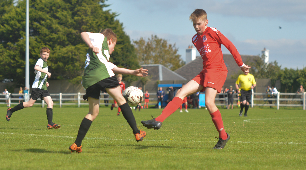 Darren O'Brien crosses the ball in the U13 Division 2 Cup Final between Sporting Ennistymon F.C and Lifford A.F.C in Frank Healy Park.