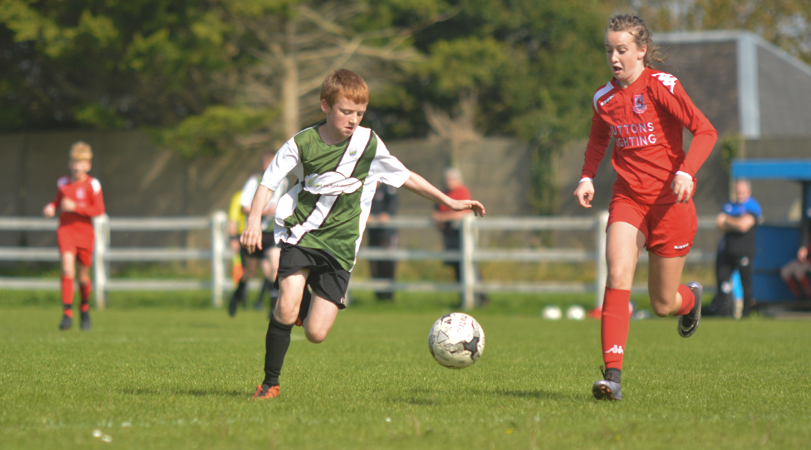 Darren O'Brien chases down a loose ball in the U13 Division 2 Cup Final between Sporting Ennistymon F.C and Lifford A.F.C in Frank Healy Park.